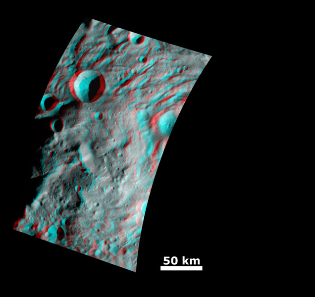 This anaglyph image from NASA's Dawn spacecraft shows the topography of the mountain-central complex in asteroid Vesta's south polar region. You need 3-D glasses to view this image.
