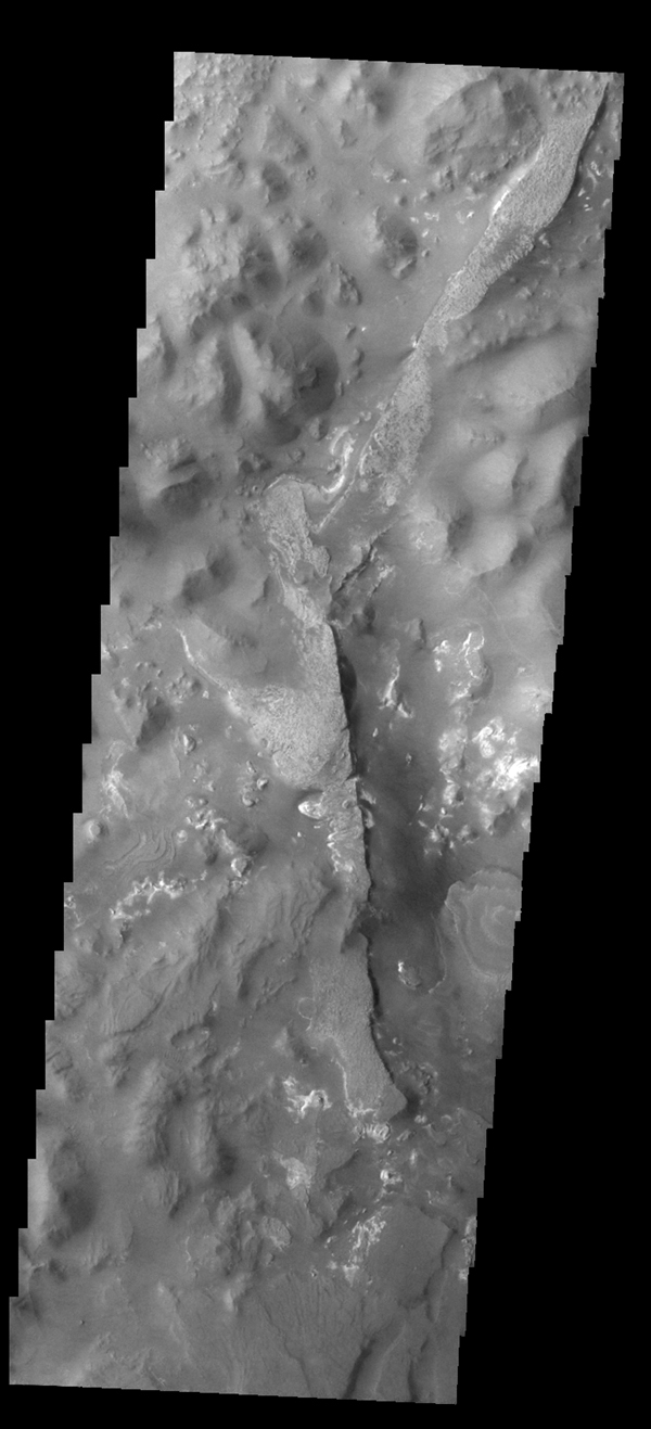 This image from NASA's 2001 Mars Odyssey spacecraft shows a portion of Aureum Chaos. Several layers of material are visible in the image.