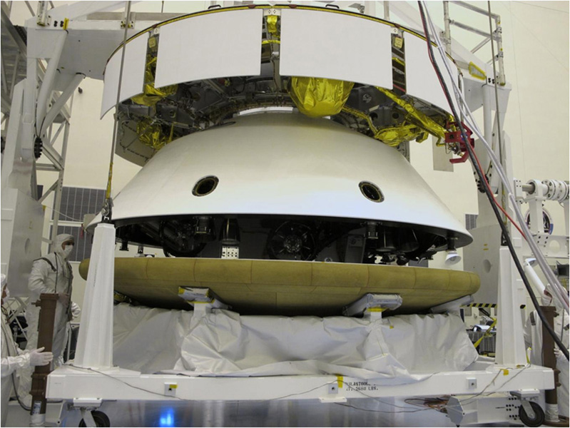 During final stacking of NASA's Mars Science Laboratory spacecraft, the heat shield is positioned for integration with the rest of the spacecraft in this photograph from inside the Payload Hazardous Servicing Facility at NASA Kennedy Space Center, Fla.