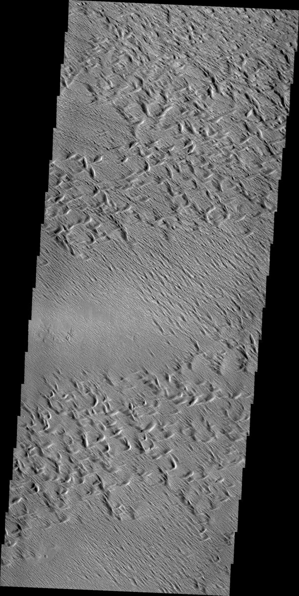 Wind erosion has created this complex surface south of Olympus Mons as seen by NASA's 2001 Mars Odyssey spacecraft.