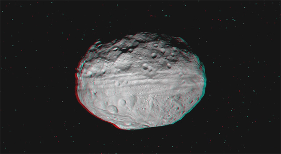 This 3D image was obtained as Dawn approached Vesta and circled the giant asteroid during the mission's survey orbit phase. You need 3D glasses to view this image.