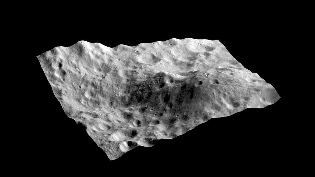 This still from a movie shows an image taken by NASA's Dawn spacecraft layered on a digital terrain model of an unusual hill containing a dark-rayed impact crater and nearby dark deposit on asteroid Vesta.