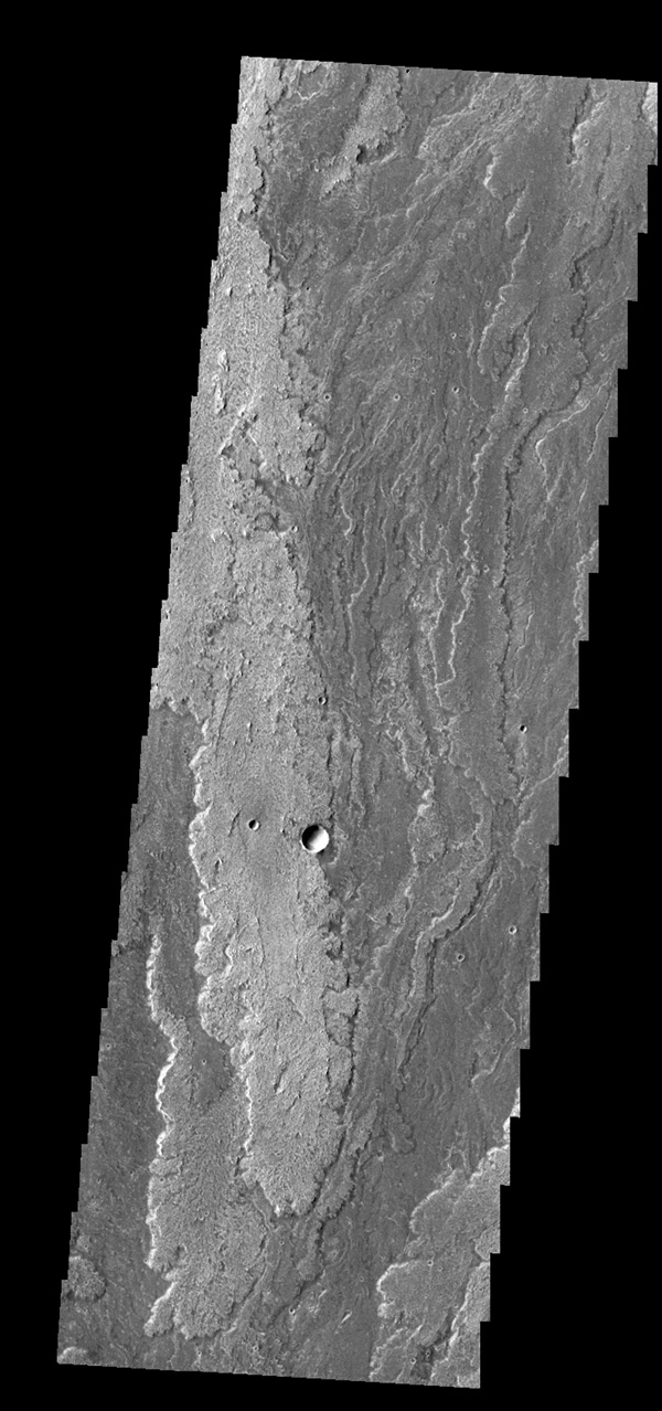 Extensive lava flows originating from Arsia Mons created Daedalia Planum. This image is from NASA's 2001 Mars Odyssey spacecraft.