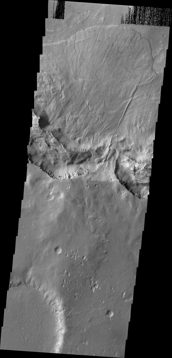 This large landslide deposit is located in an unnamed crater southwest of Holden Crater. This image was captured by NASA's 2001 Mars Odyssey spacecraft.