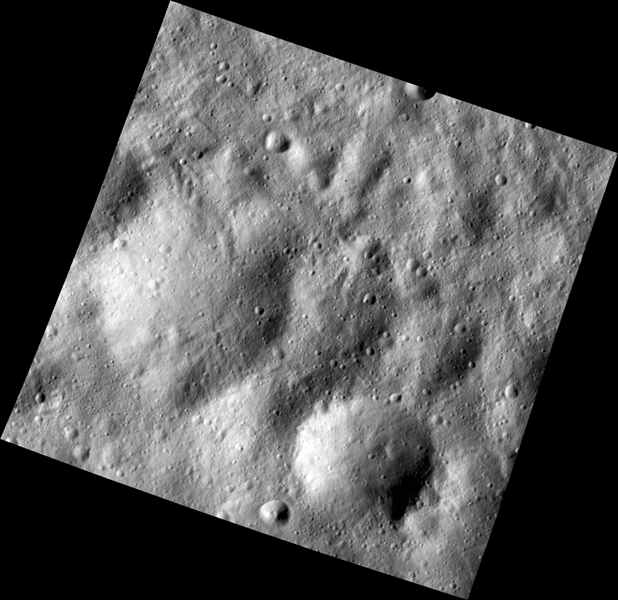 This image, one of the first obtained by NASA's Dawn spacecraft in its low altitude mapping orbit, shows many buried craters located within the equatorial trough region of the giant asteroid Vesta.