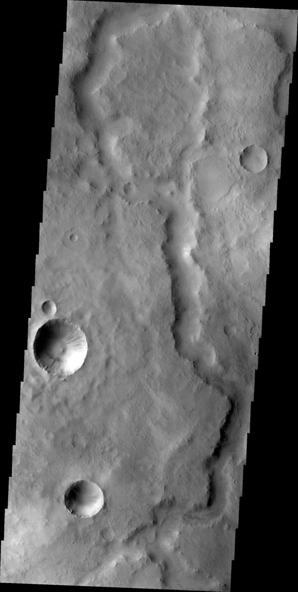 The unnamed channel in this image captured by NASA's 2001 Mars Odyssey spacecraft is located southeast of Tikhonravov Crater in Terra Sabaea.