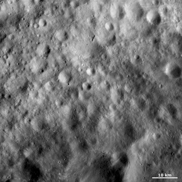 This image from NASA's Dawn spacecraft shows old cratered terrain located on asteroid Vesta's equator. Many of these craters have very degraded, rounded rims.