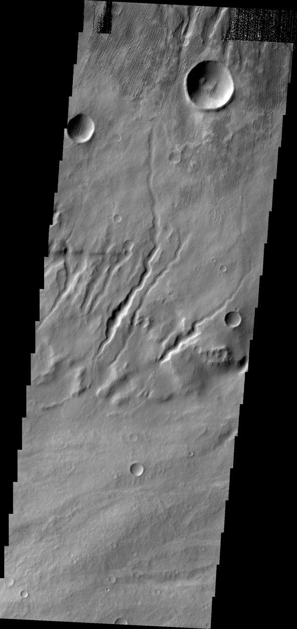 Channels are dissecting the flank of Apollinaris Mons in this image from NASA's 2001 Mars Odyssey spacecraft.
