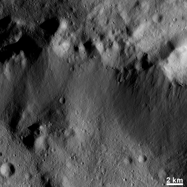 This image from NASA's Dawn spacecraft shows many highly degraded craters in the top part of the image. These craters are so degraded that their rims are only partially visible.