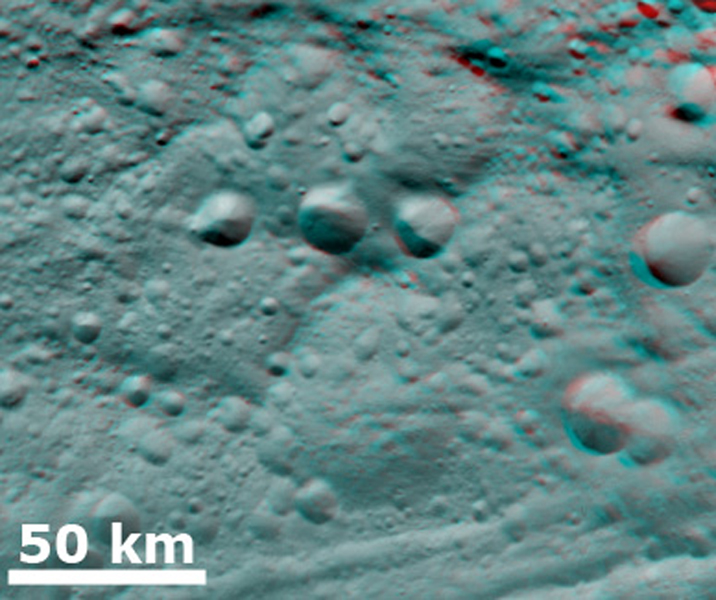 This anaglyph from NASA's Dawn spacecraft shows degraded craters in asteroid Vesta's northern hemisphere. You need 3D glasses to view this image.