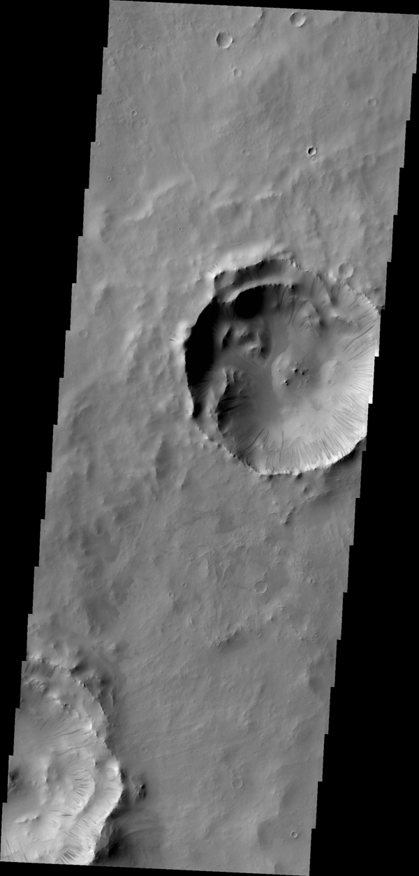 A multitude of dark slope streaks mark the inner rim of this unnamed crater in Terra Sabaea. This image is from NASA's 2001 Mars Odyssey spacecraft.
