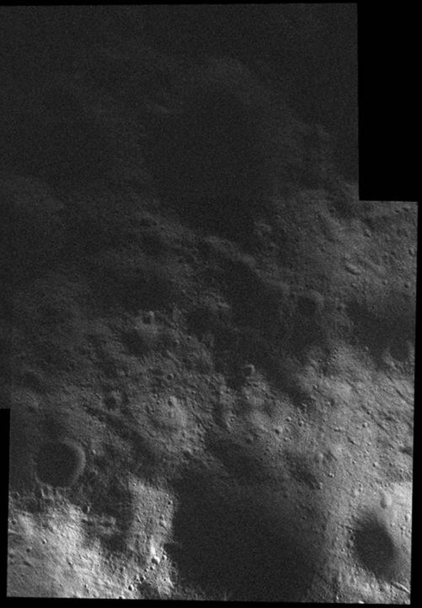 This mosaic of the surface of asteroid Vesta was made from images obtained by NASA's Dawn spacecraft while the area was entirely in the sun's shadow. Light reflecting off of other areas of Vesta provides the only illumination.