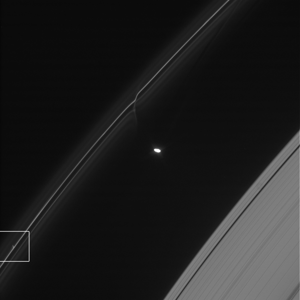 One of the glittering trails caused by small objects punching through Saturn's F ring is highlighted in this image from NASA's Cassini spacecraft. These trails show how the F ring, the outermost of Saturn's main rings, is constantly changing.
