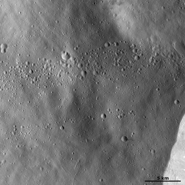 This image from NASA's Dawn spacecraft shows is located in asteroid Vesta's Rheasilvia quadrangle, near Vesta's south pole. Severina crater has a fresh, sharp rim and a smaller, presumably younger, crater on its rim.