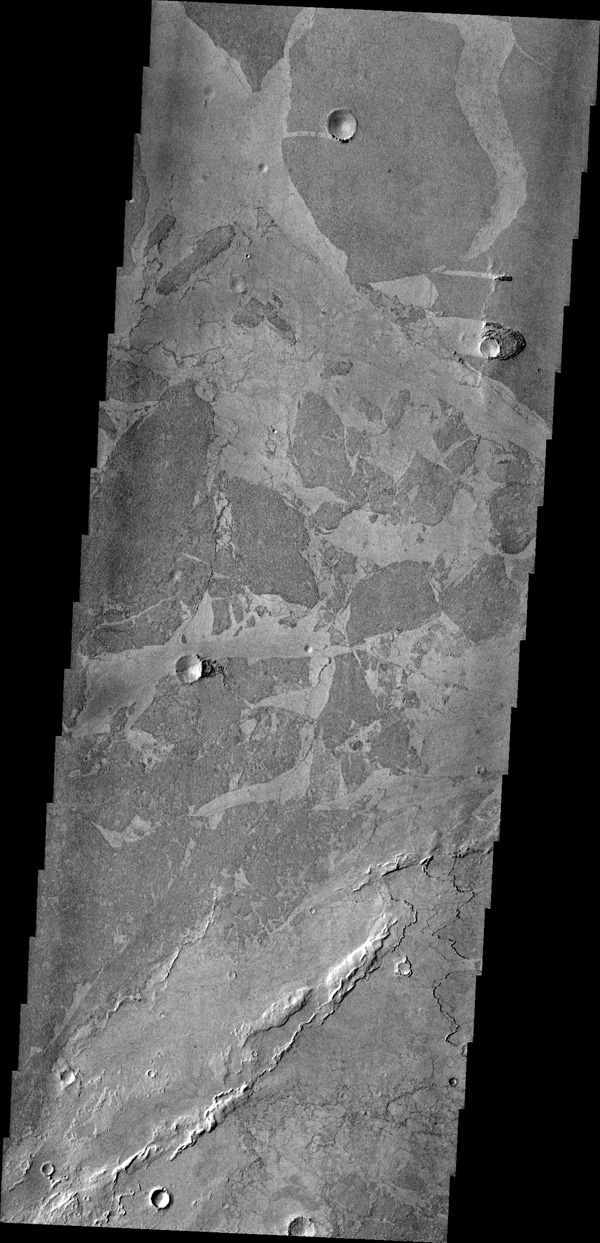 Platy lava flows in Elysium look very different from the thicker flows of the Tharsis region. In this image from NASA's 2001 Mars Odyssey spacecraft, the darker plates are separated by lighter material and some edges 'match-up' like puzzle pieces.