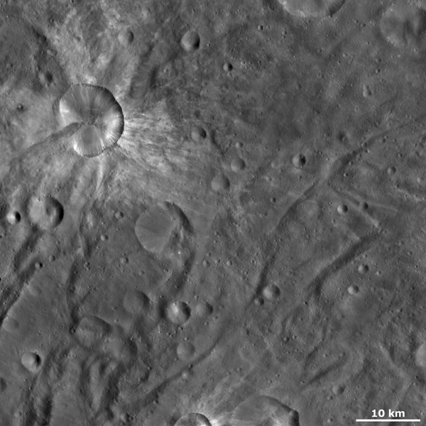 This image from NASA's Dawn spacecraft of asteroid Vesta shows Canuleia crater, a large, irregularly shaped crater. Other interesting features of Canuleia include the diffuse bright material that is both inside and outside of its rim.