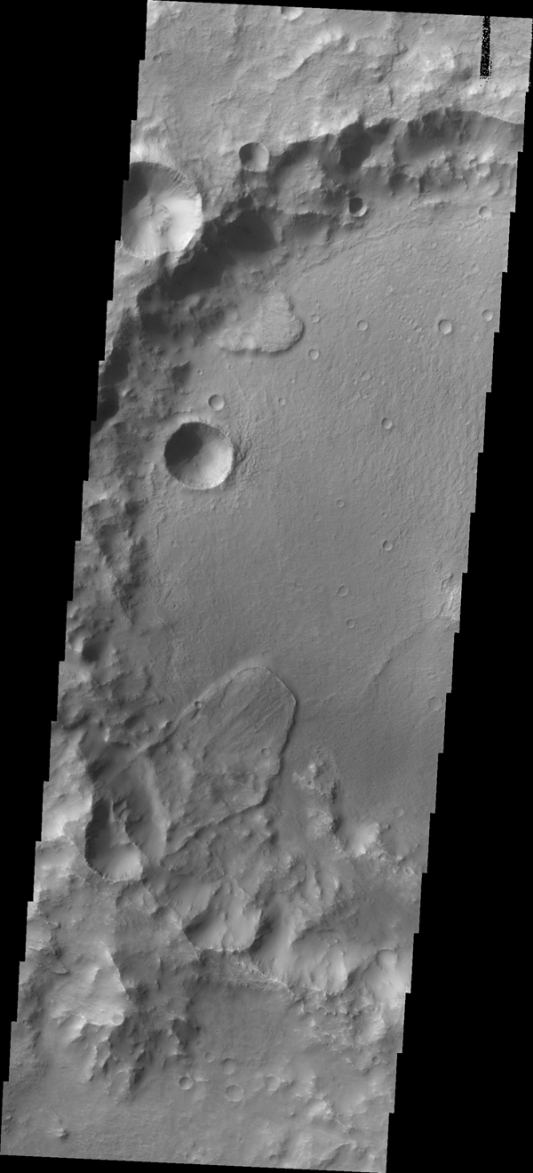 Landslide deposits cover part of the floor of this unnamed crater in Tyrrhena Terra as seen by NASA's 2001 Mars Odyssey spacecraft.