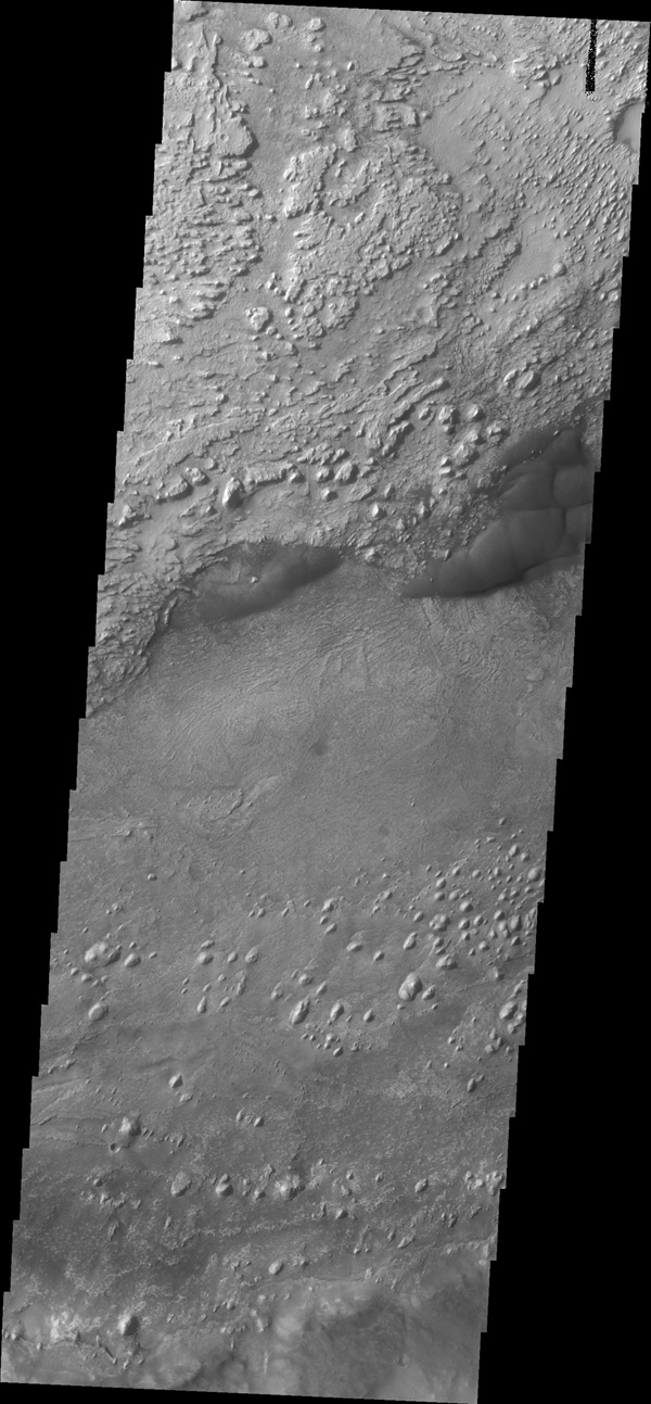 This image from NASA's 2001 Mars Odyssey spacecraft shows a portion of the floor of Crommelin Crater. This crater contains a large mound of material that filled a large part of the crater and has been subsequently eroded.