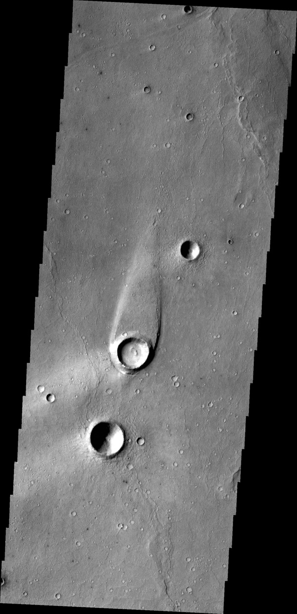 The streamlined island in this image from NASA's 2001 Mars Odyssey spacecraft formed within the channel of Maja Valles. The flow of water was deflected by the crater leaving material in the lee of the crater.