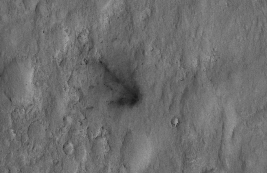 This close-up view captured by NASA's Mars Reconnaissance Orbiter shows darkened radial jets caused by the impact of Curiosity's sky crane, which helped deliver the rover to the surface of Mars.