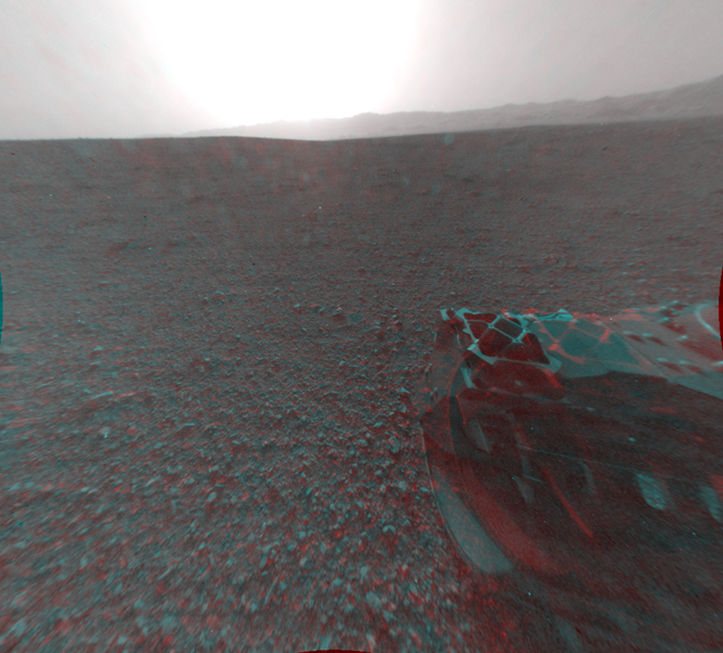 This image is a 3-D view behind NASA's Curiosity rover. The anaglyph was made from a stereo pair of Hazard-Avoidance Cameras on the rear of the rover. It has been cropped.