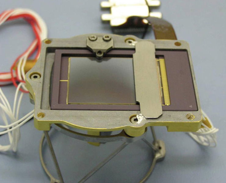 This charged couple device (CCD) is part of the CheMin instrument on NASA's Curiosity rover. When CheMin directs X-rays at a sample of soil, this imager, which is the size of a postage stamp, detects both the position and energy of each X-ray photon.