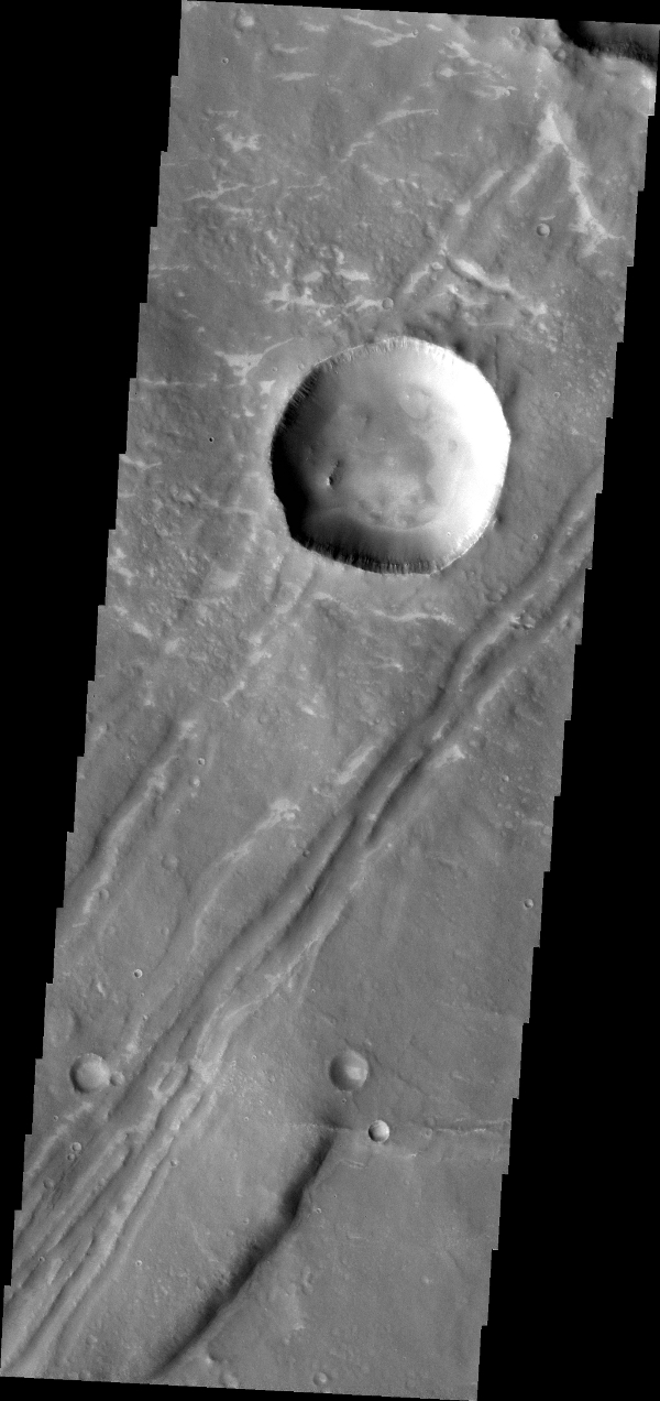 The depressions and offset ridge in this image captured by NASA's Mars Odyssey spacecraft are evidence of faulting in this region of Sinai Dorsa.