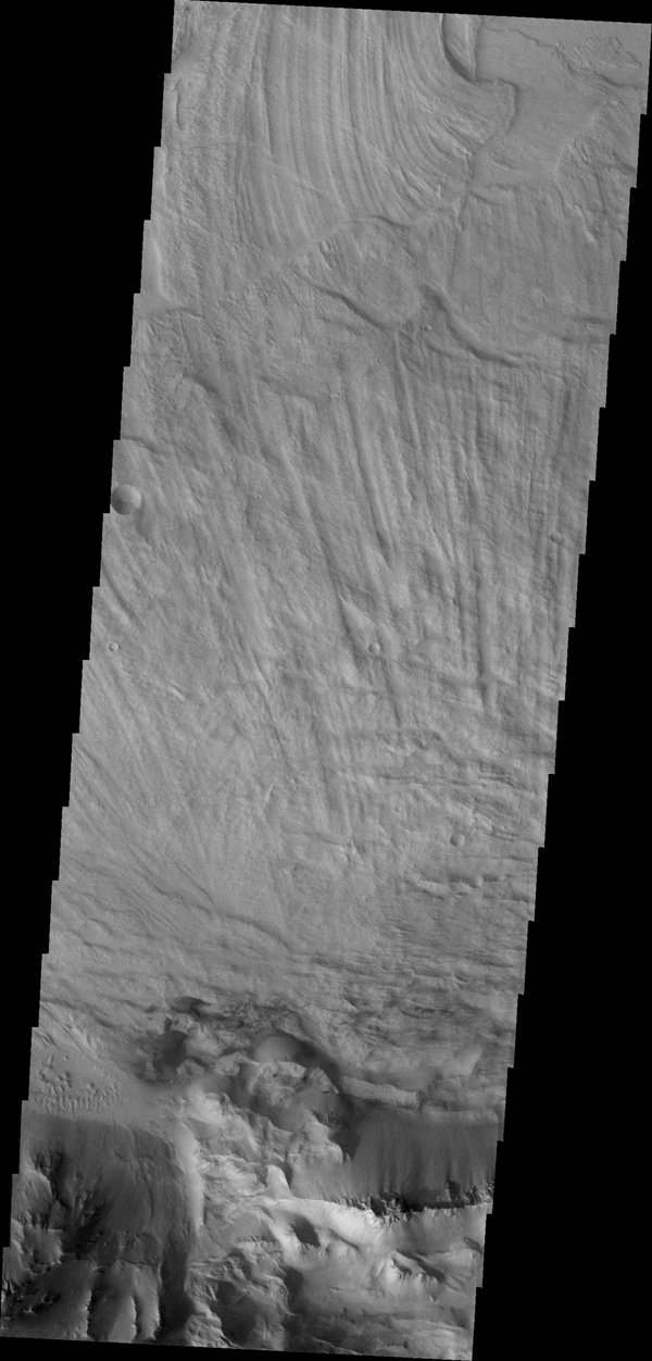 The finely ridged material in this image captured by NASA's 2001 Mars Odyssey spacecraft are huge landslide deposits called Coprates Labes. These landslide deposits are located on the floor of Coprates Chasma.