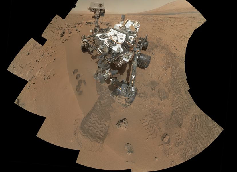 This mosaic from NASA's Mars rover, Curiosity, shows the first four of five places from which the rover's scoop obtained sand to clean the sample handling and processing system.