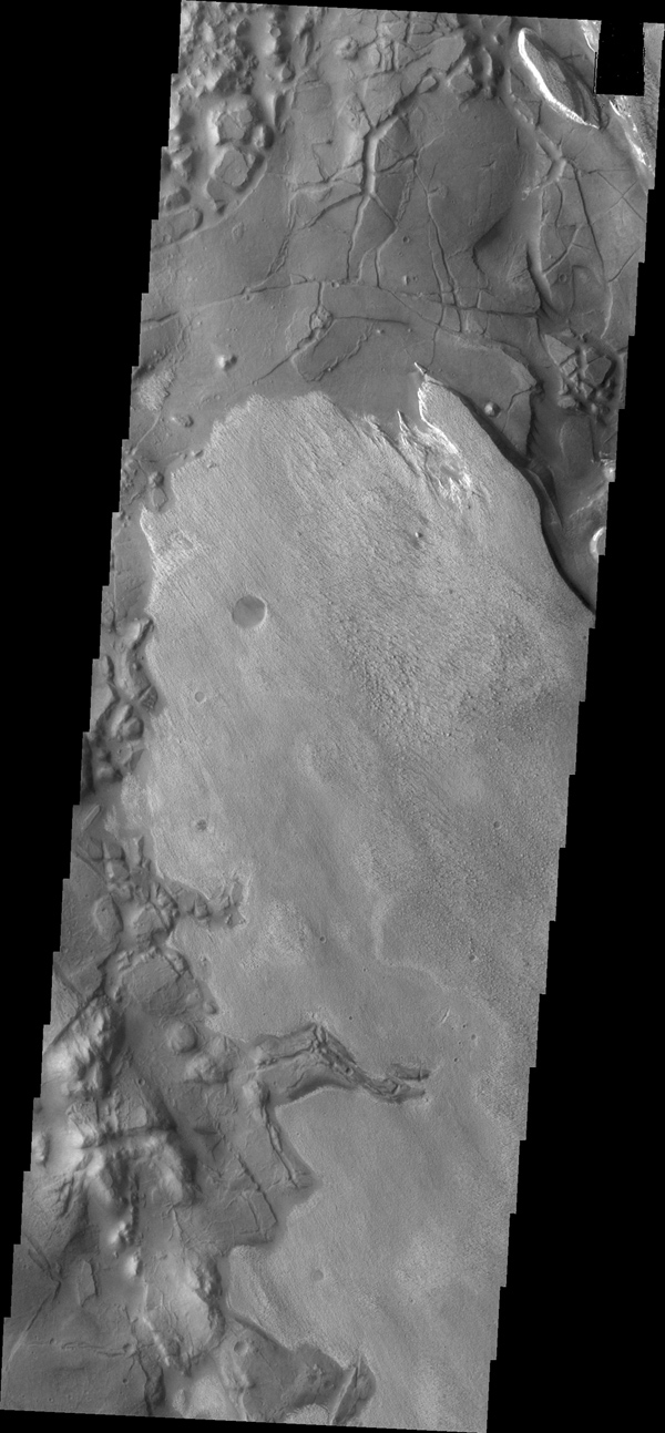This image captured by NASA's 2001 Mars Odyssey spacecraft shows part of Aram Chaos. There are several layers of material in this region.