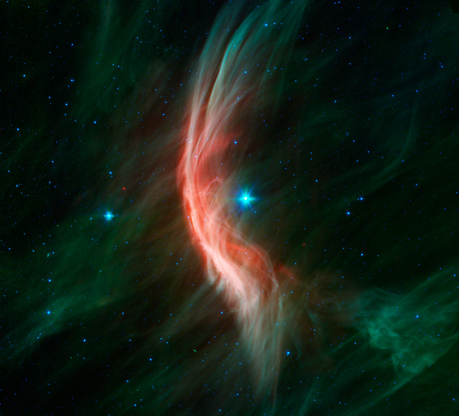 The giant star Zeta Ophiuchi, a young, large and hot star located around 370 light-years away, is having a 'shocking' effect on the surrounding dust clouds in this infrared image from NASA's Spitzer Space Telescope.