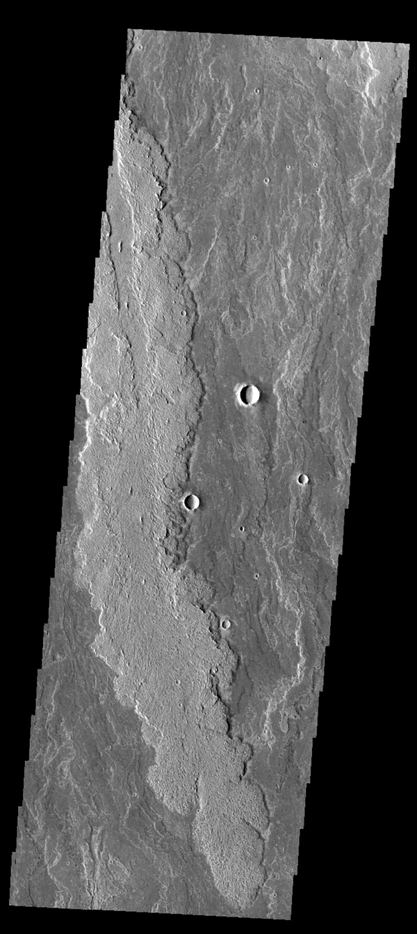 The lava flows in image from NASA's 2001 Mars Odyssey spacecraft are part of the vast flow field originating from Arsia Mons.