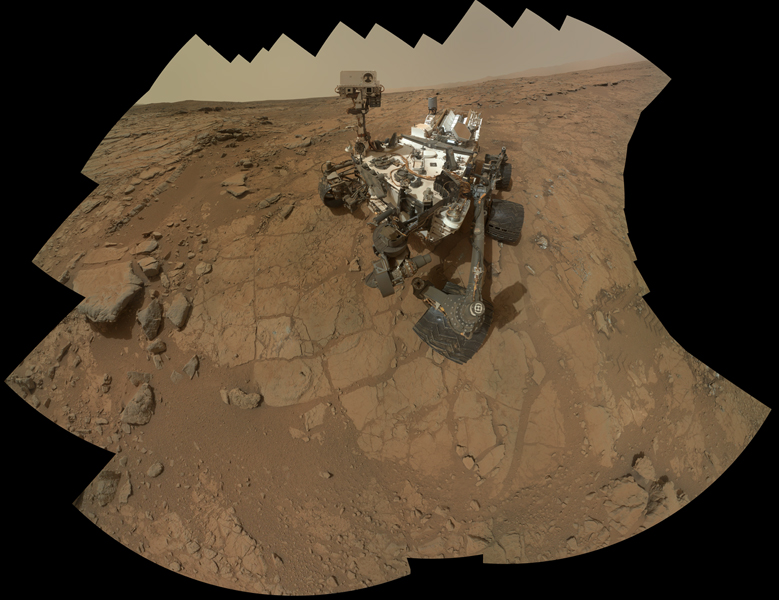 The rover is positioned at a patch of flat outcrop called 'John Klein,' which was selected as the site for the first rock-drilling activities by NASA's Curiosity. This self-portrait was acquired to document the drilling site.