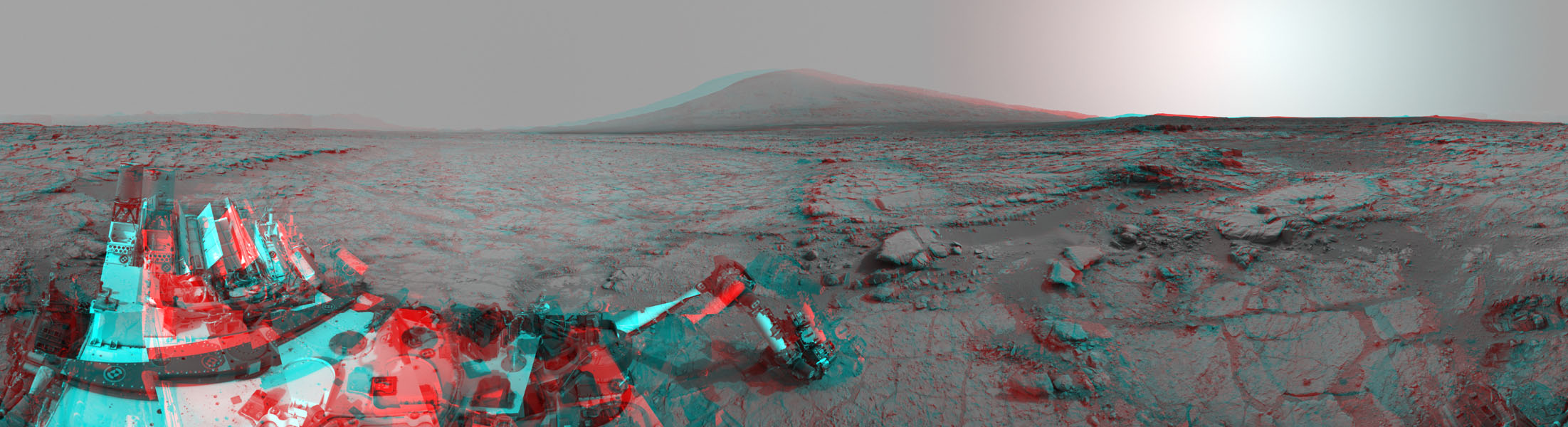 The left and right eyes of the Navigation Camera (Navcam) in NASA's Curiosity Mars rover took the dozens of images combined into this 3-D scene of the rover and its surroundings.