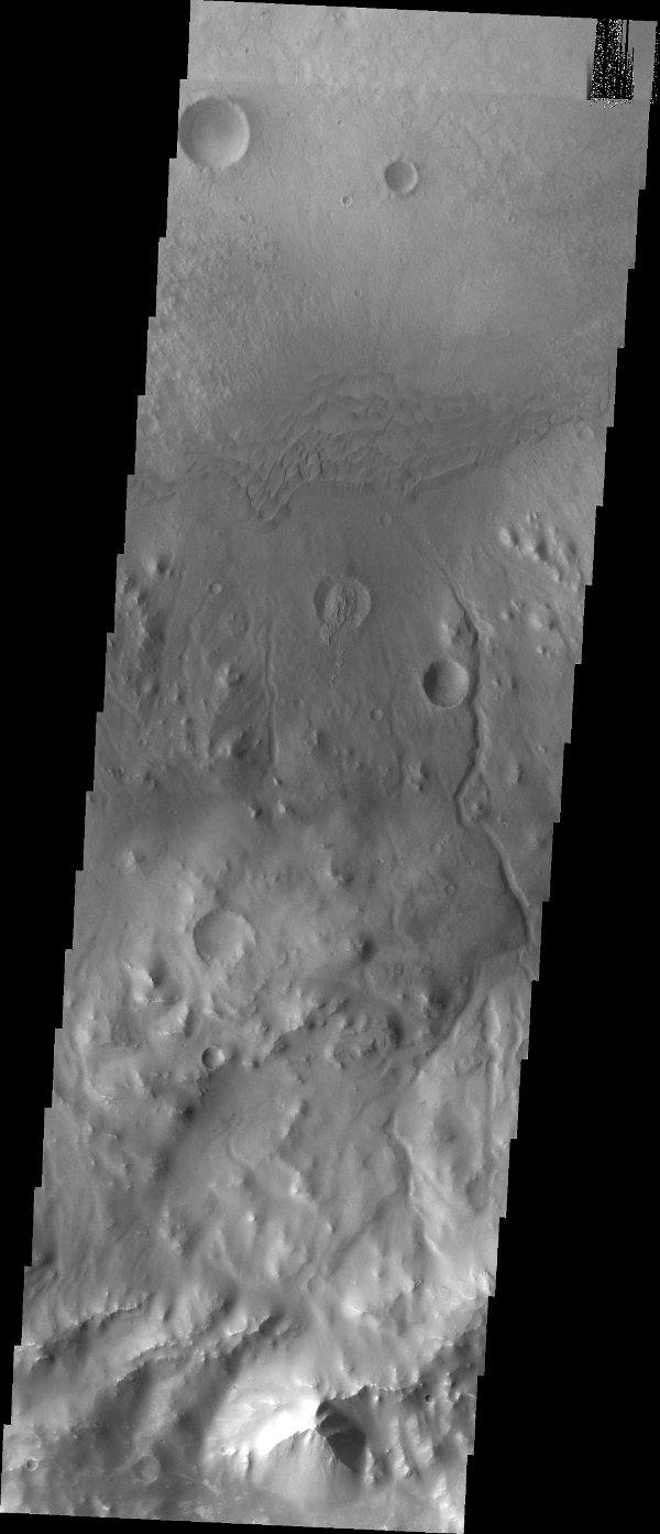 Following the dunes eastward, we find several channels dissecting the crater rim in this image from NASA's Mars Odyssey spacecraft. These channels may be the source of material for the sand dunes.