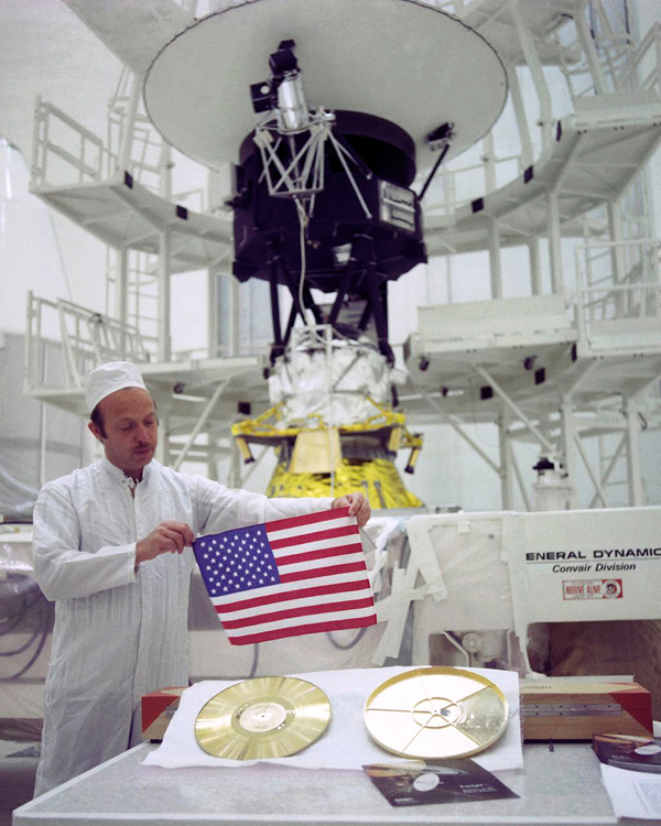 As NASA's two Voyager spacecraft travel out into deep space, they carry a small American flag and a Golden Record packed with pictures and sounds -- mementos of our home planet.