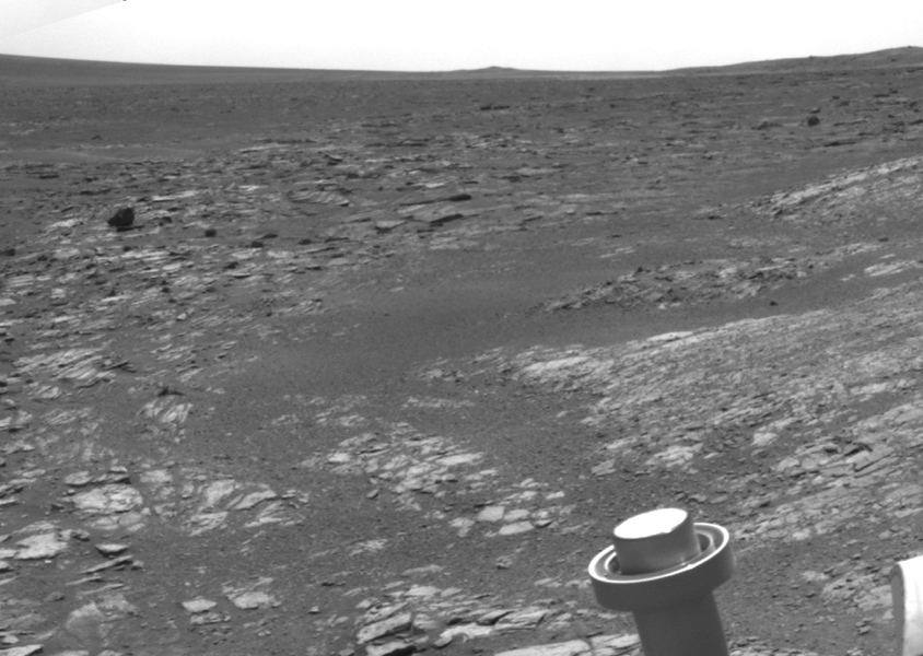 NASA's Mars Exploration Rover Opportunity used its navigation camera to acquire this view looking toward the southwest. The scene includes tilted rocks at the edge of a bench surrounding 'Cape York,' with Burns formation rocks exposed in 'Botany Bay.'