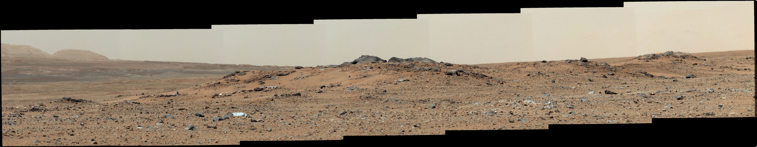 A rise topped by two gray rocks near the center of the scene is informally named 'Twin Cairns Island' as seen by NASA's Mars rover Curiosity. The center of the scene is toward the southwest.