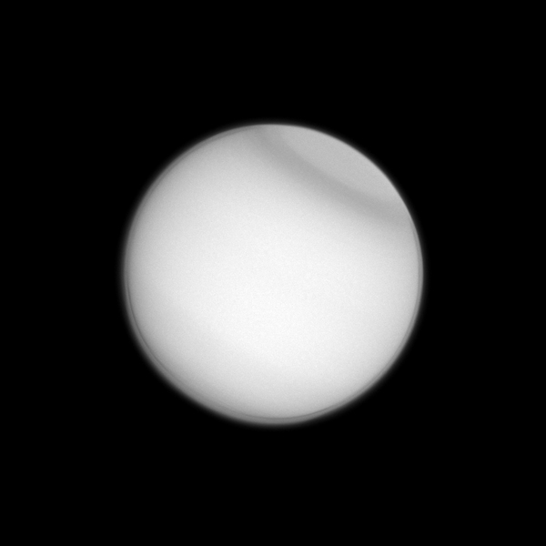 Titan's polar collar, previously seen by Voyager 2 and the Hubble Space Telescope, has now been observed by the Cassini spacecraft, seen here in ultraviolet light. The collar is believed to be seasonal in nature.