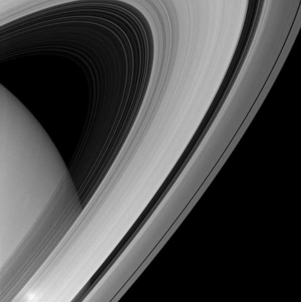 Saturn's rings appear to form a majestic arc over the planet in this image from NASA's Cassini spacecraft.