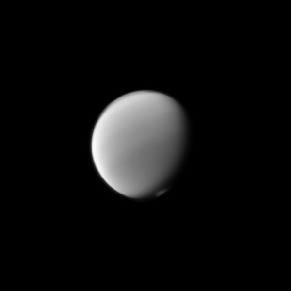 Titan's atmosphere puts on a display with the detached haze to the north (top of image) and the polar vortex to the south as seen by NASA's Cassini spacecraft.