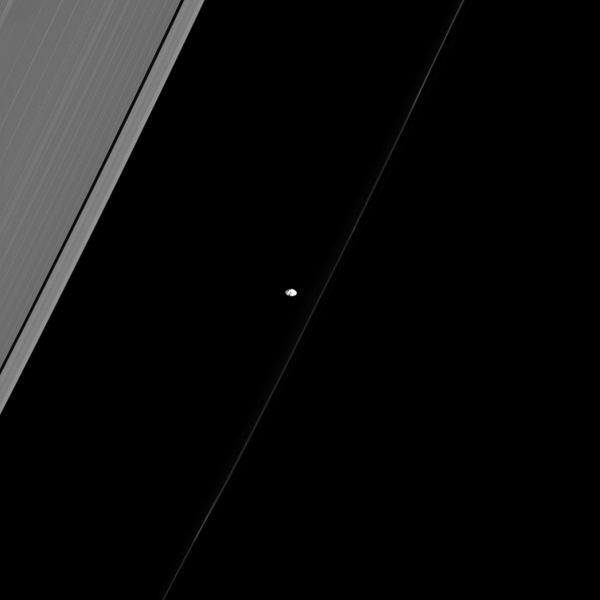 Similar to many of the small, inner moons of Saturn, Prometheus points its long axis at Saturn as if giving us directions to the planet. This image was taken by NASA's Cassini spacecraft.