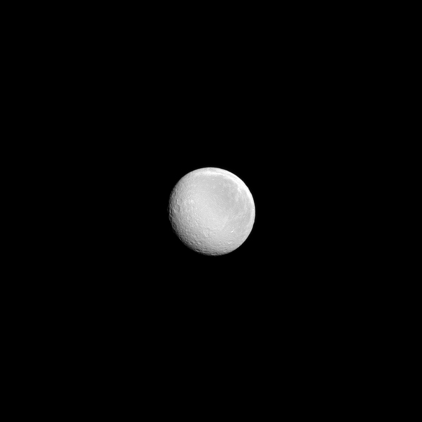 A nearly full Rhea shines in the sunlight in this image from NASA's Cassini spacecraft. Rhea (949 miles, or 1,527 kilometers across) is Saturn's second largest moon.