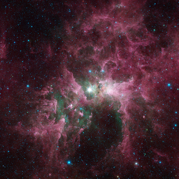Massive stars can wreak havoc on their surroundings, as can be seen in this new view of the Carina nebula from NASAs Spitzer Space Telescope.