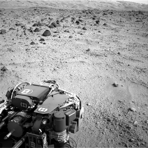 Lower slopes of Mount Sharp appear at the top of this image taken by the right Navigation Camera (Navcam) of NASA's Mars rover Curiosity at the end of a drive of about 135 feet during the 329th Martian day, or sol, of the rover's work on Mars.