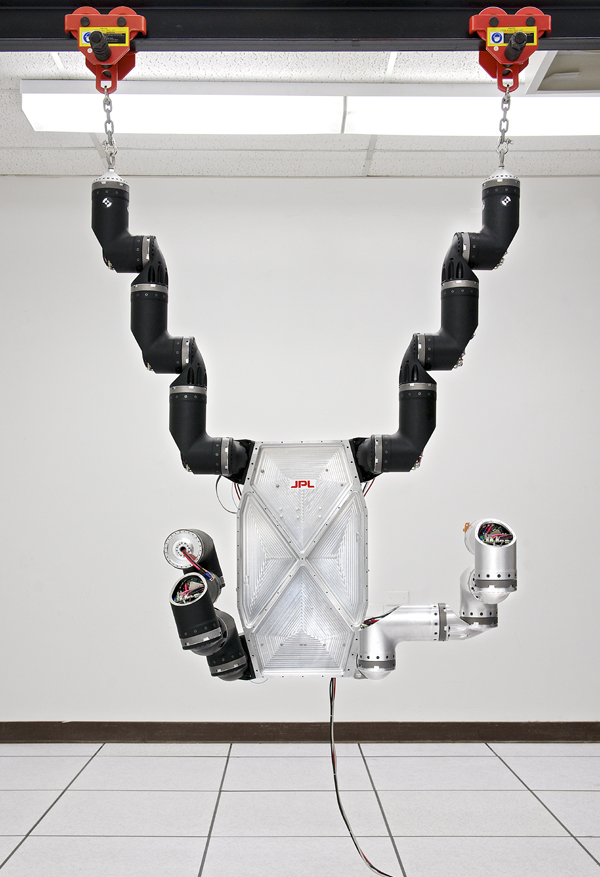 RoboSimian, a disaster-relief robot hanging from fixture