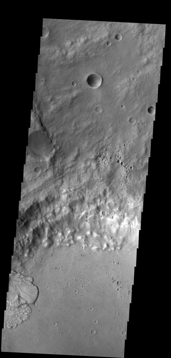 This image shows one of the two landslide deposits within this unnamed crater north of Ares Vallis as seen by NASA's 2001 Mars Odyssey spacecraft.