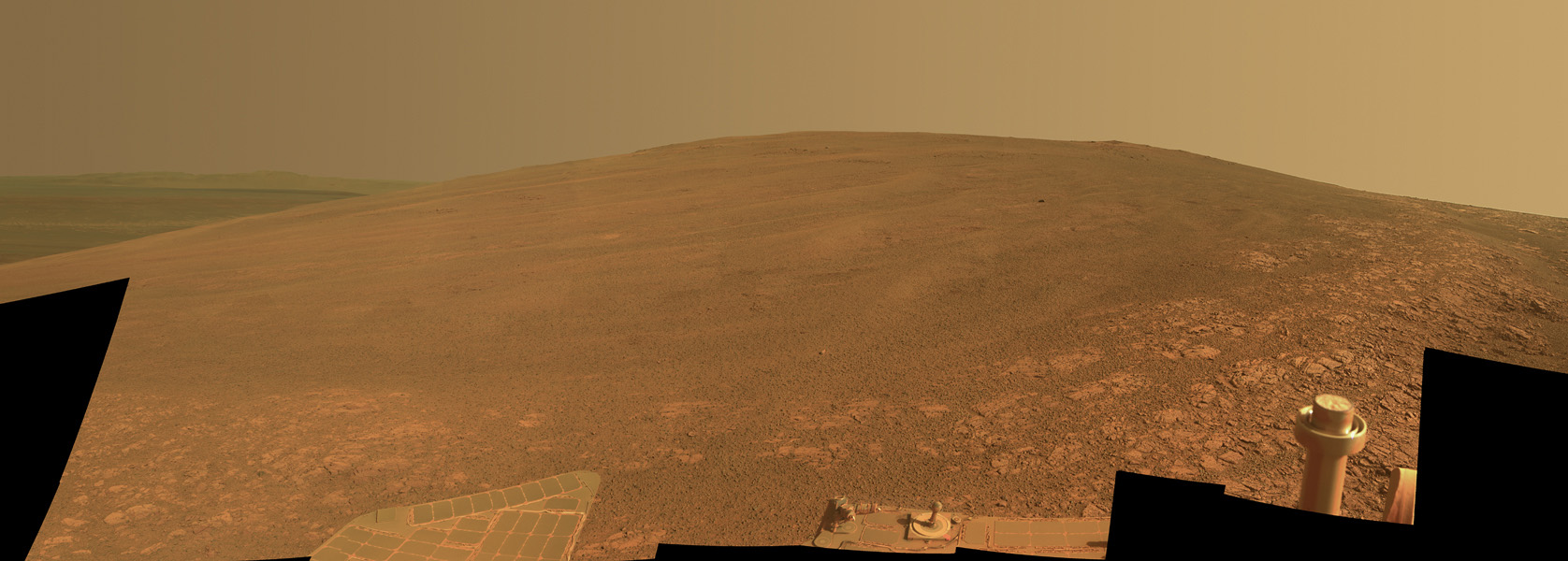 This scene shows the 'Murray Ridge' portion of the western rim of Endeavour Crater on Mars as seen by NASA's rover Opportunity; this feature is called Murray Ridge in tribute to Bruce Murray (1931-2013), an influential advocate for planetary exploration.