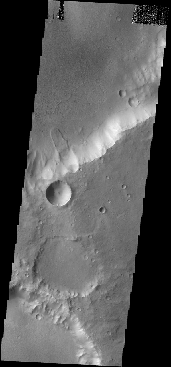 A small landslide deposit of an unnamed crater is visible in this image captured by NASA's 2001 Mars Odyssey spacecraft.
