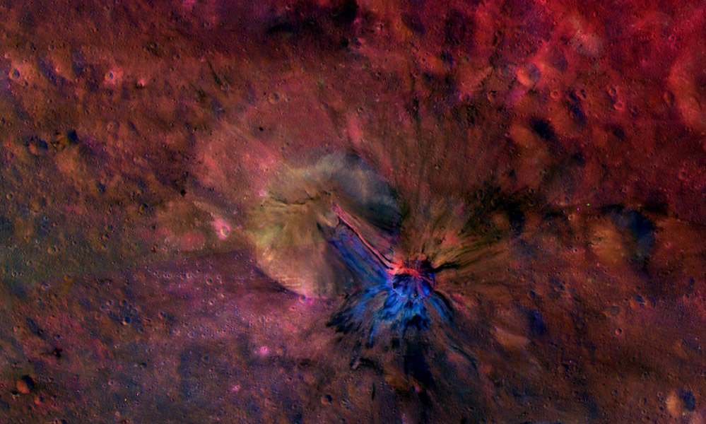 This colorful composite image from NASA's Dawn mission shows the flow of material inside and outside a crater called Aelia on the giant asteroid Vesta. To the naked eye, these structures would not be seen. But here, they stand out in blue and red.